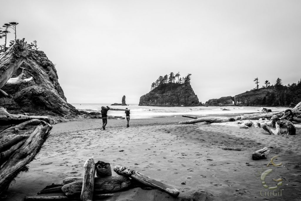 A humbling moment, where CrtrGrl helps a homeless man carry drift logs to build a shelter from the cold on 2nd Beach, WA. Photo by Scott McGee at Under Pressure Photography